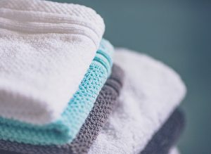 Stack of freshly laundered towels and washcloths